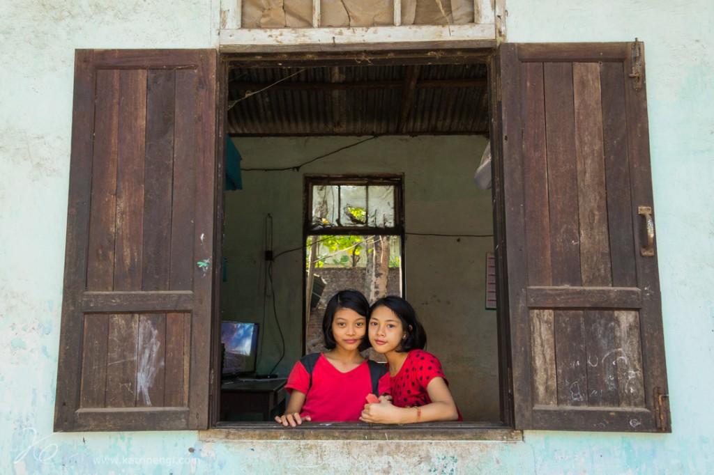 Girls in red best friends in a window