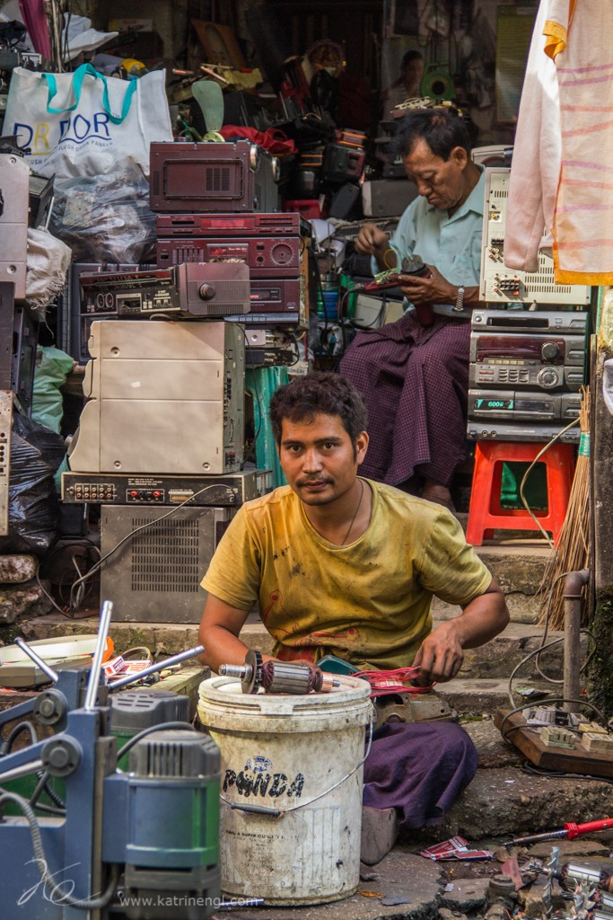 Men repair work Yangon