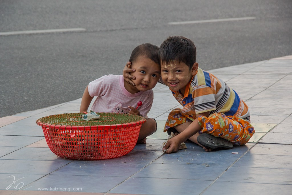 Children selling birds on the street in Yangon